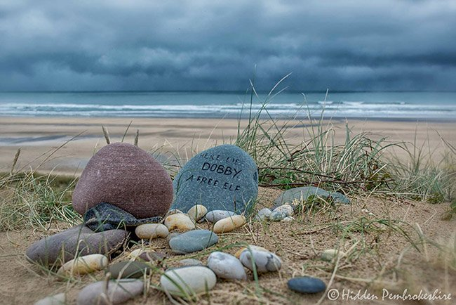 Here lies Dobby, a free elf - You can now visit Dobby's grave in Freshwater West, Pembrokeshire, Wales.